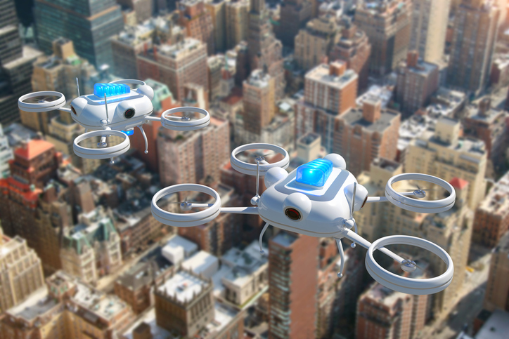 Police drones with blue emergency lights flying over New York