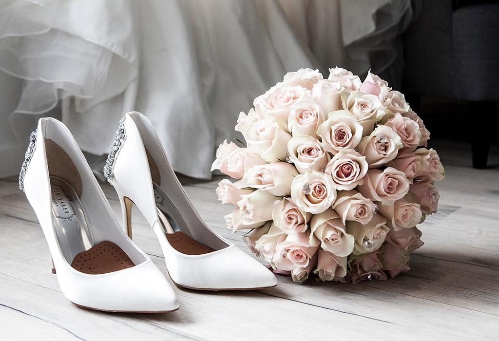 white wedding heels and flowers